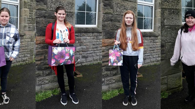 From left to right: Winner - Seren-Haf Davies, runner up - Llinos Dando and highly commended - Kaitlin Law and Maegen Kenvin with their art prizes.