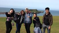 International students enjoy a day out at Rhossili Bay